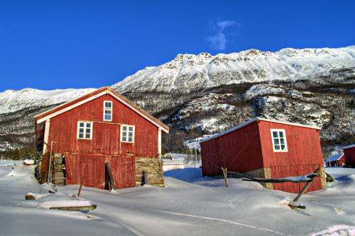 Photo of two boathouses in a winter landscape