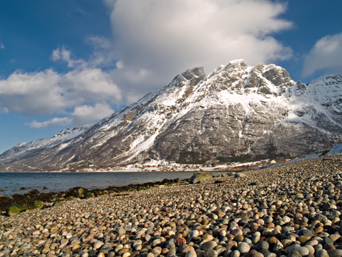 Photo of winter mountain and pebble beach
