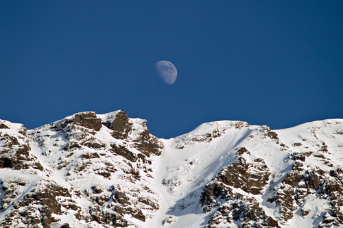 Photo of moon over winter mountain