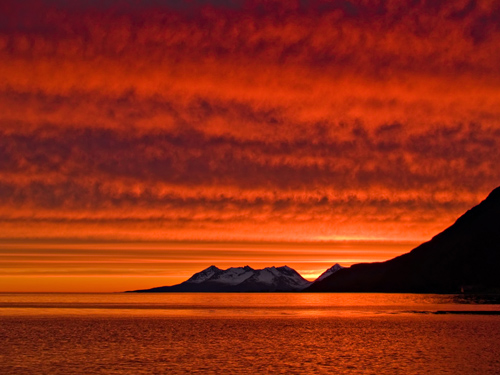 Photo of amazing red sunset at midnight in northern Norway