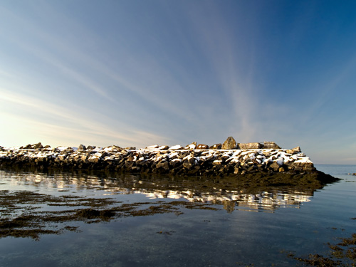 Photo of snowy seawall in the winter