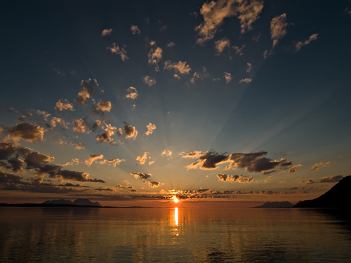 Wide angle picture of sunset on a beach in northern Norway