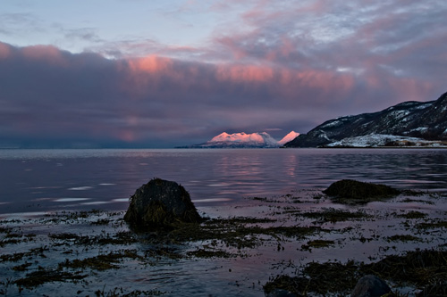 Picture from the coast in the Northern Norway - Alpenglow in the mountains and clouds