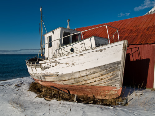 Picture of decaying old Norwegian fishing boat on land