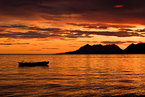 Picture of rowboat and beautiful sunset in northern Norway