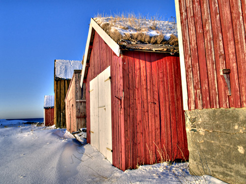 Row of Norwegian boathouses on a winter day