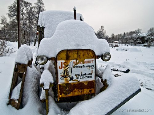 Picture of tractor covered with snow - 40 cm snowfall in one day in Norway