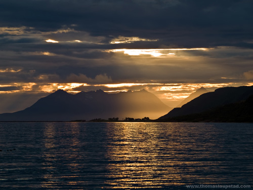 Midnight sunset picture of village in the sea in Northern Norway